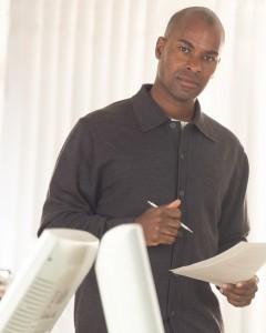 Businessman Reading Document ca. 2003